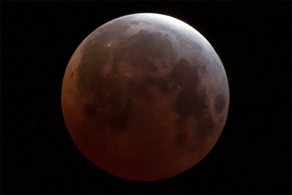 """<div class=""""meta image-caption""""><div class=""""origin-logo origin-image none""""><span>none</span></div><span class=""""caption-text"""">A lunar eclipse is seen from Mentone, California, in this photo from ABC7 viewer Ron Kroetz using the #ABC7Eyewitness.</span></div>"""