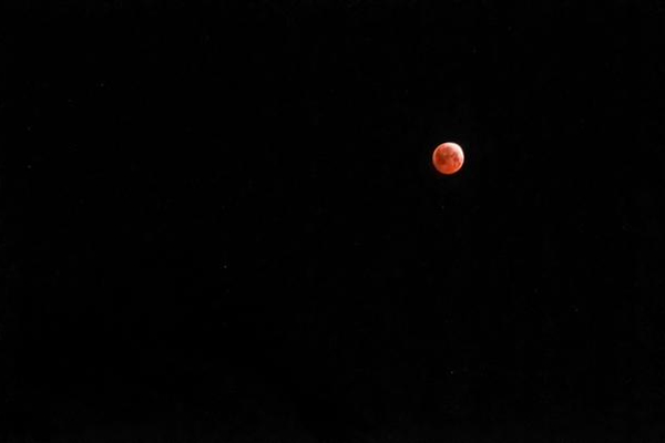 """<div class=""""meta image-caption""""><div class=""""origin-logo origin-image none""""><span>none</span></div><span class=""""caption-text"""">A lunar eclipse is seen from San Clemente, California, in this photo from ABC7 viewer Tom using the #ABC7Eyewitness.</span></div>"""