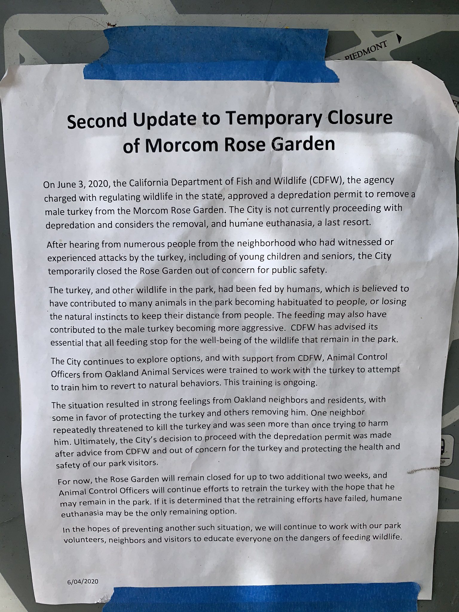 A notice, posted at Oakland's Morcom Rose Garden, informs visitors of a closure due to an aggressive turkey.