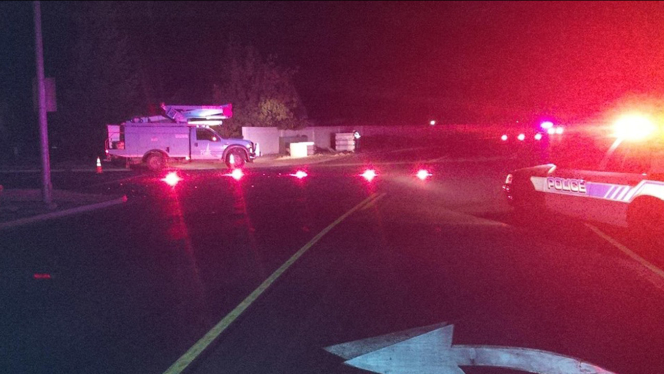 Madera police respond to a hit-and-run crash on Raymond Road near Cleveland Avenue on Friday, April 3, 2015.