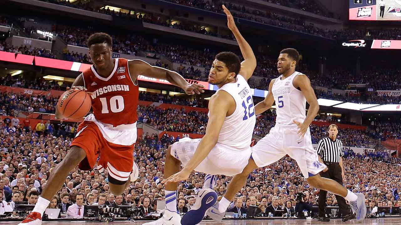Wisconsin's Nigel Hayes (10) drives against Kentucky's Karl-Anthony Towns (12) during the second half of the NCAA Final Four tournament college basketball semifinal game Saturday, April 4, 2015, in Indianapolis.