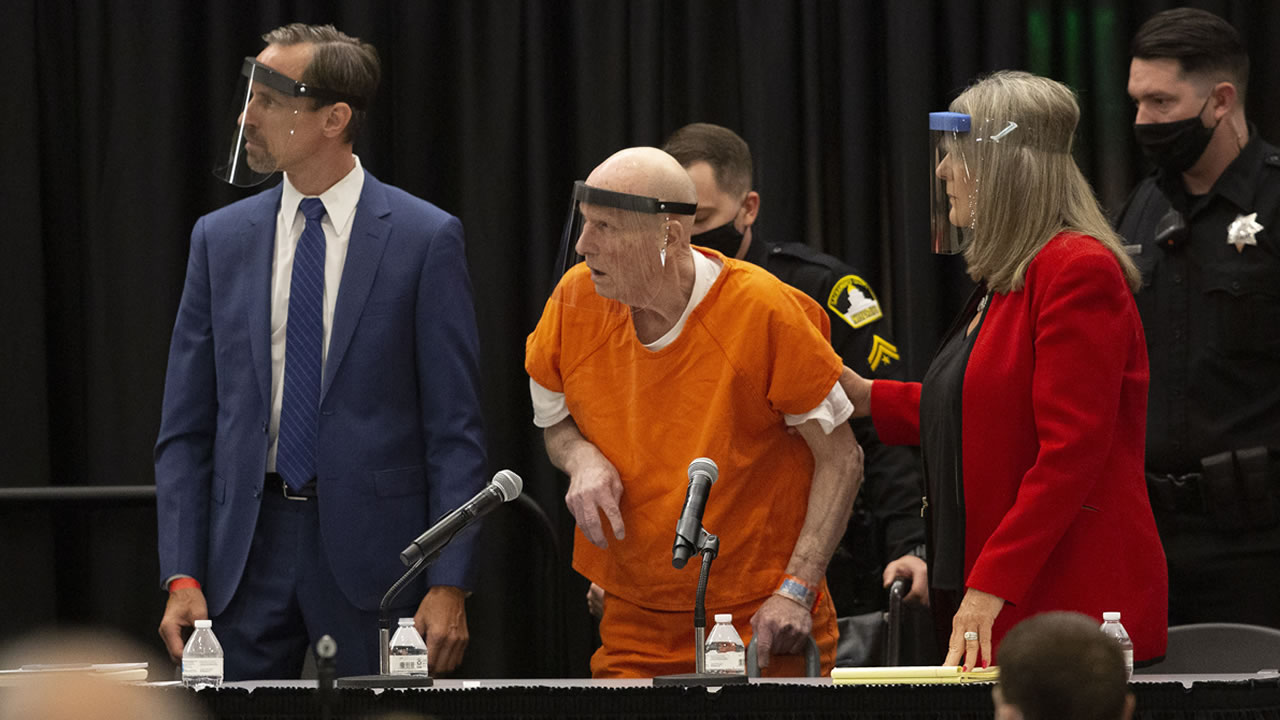 Joseph James DeAngelo, center, charged with being the Golden State Killer, stands in a courtroom in Sacramento, Calif. Monday June 29, 2020.