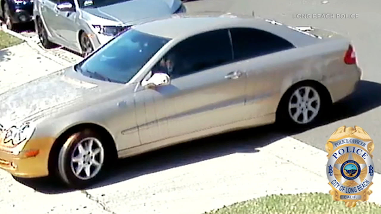 Two suspects in the beating and robbery of a Long Beach street vendor fled in this tan Mercedes coupe, police say.
