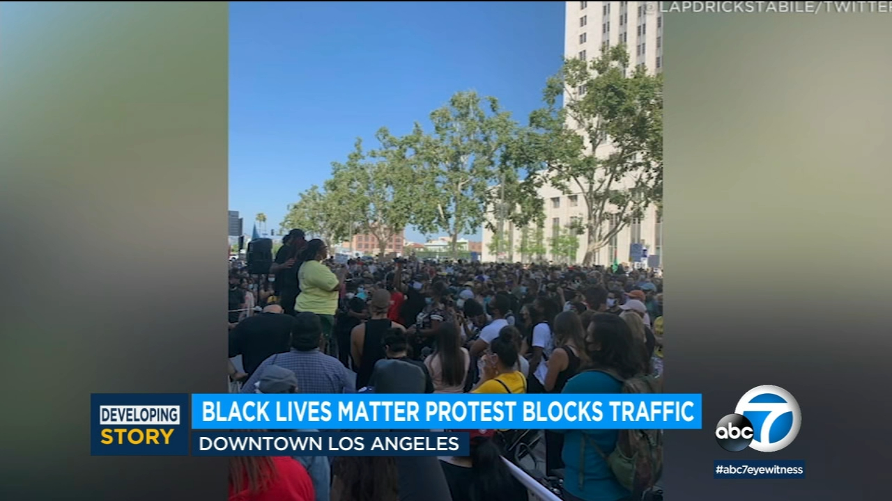Group of Black Lives Matter protesters walk onto 110 Freeway in downtown Los Angeles
