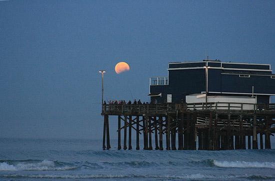 "<div class=""meta image-caption""><div class=""origin-logo origin-image none""><span>none</span></div><span class=""caption-text"">Thanks to an ABC7 viewer for sending us a partial image of the eclipse over the Newport Beach pier.</span></div>"