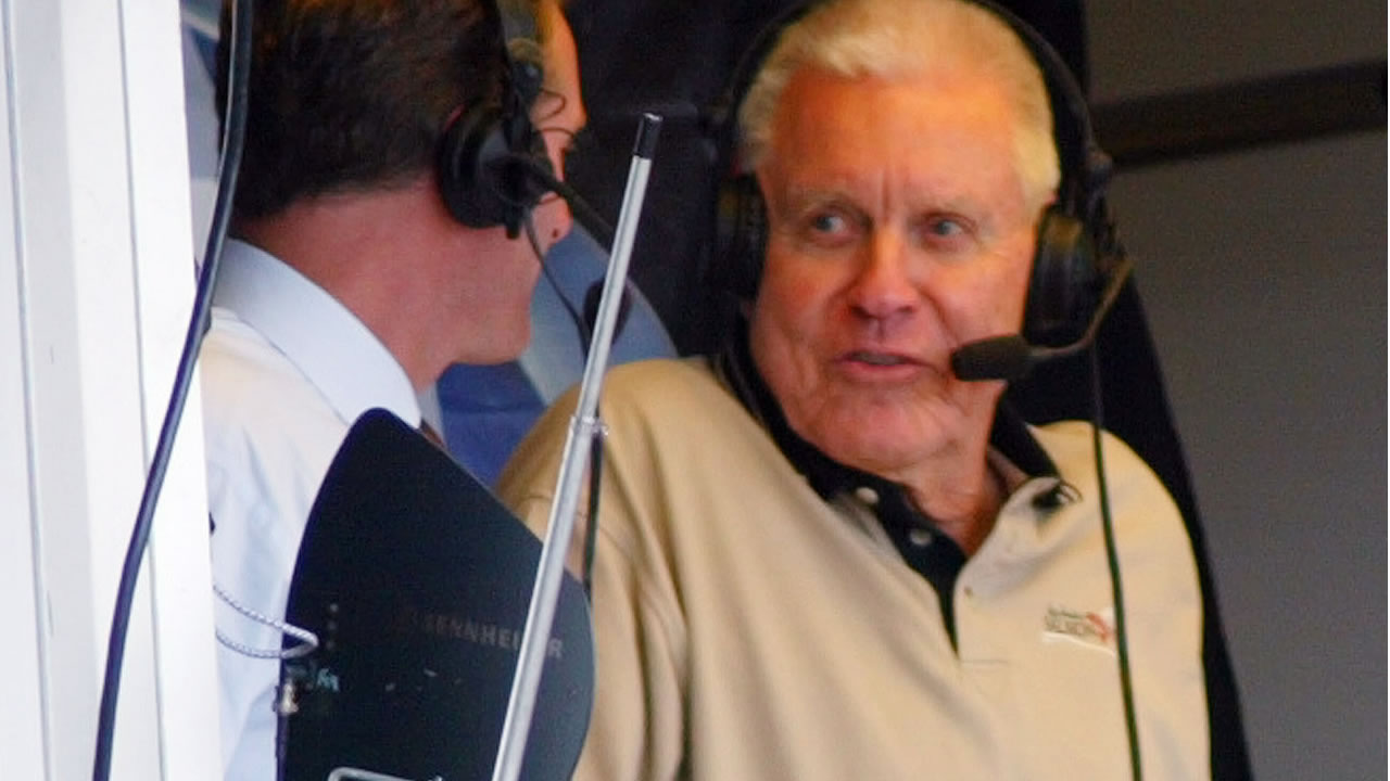 FILE - In this Sept. 28, 2002, file photo, Lon Simmons makes an appearance in the broadcast booth during the 8th inning of a Giants' game in San Francisco. (AP Photo)