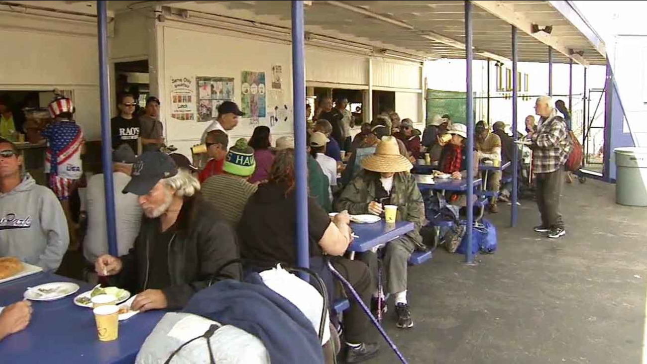 A man who goes by the moniker 'Robin Hood' hosted a free dinner for the needy and less fortunate at St. Anne Catholic Church and Shrine in Santa Monica Sunday, April 5, 2015.