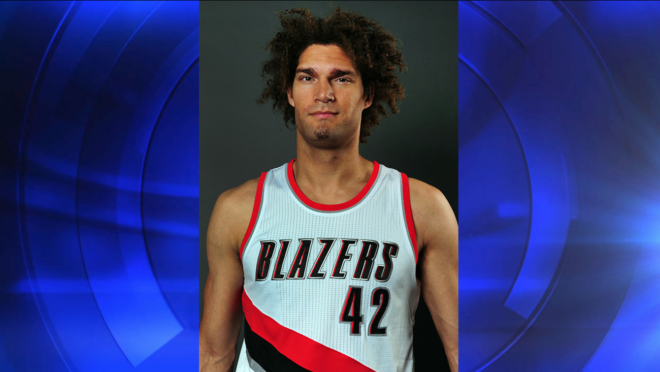 Portland Trail Blazers center Robin Lopez (42) poses for a photograph during the NBA basketball team's media day in Portland, Ore., Monday, September 29, 2014.