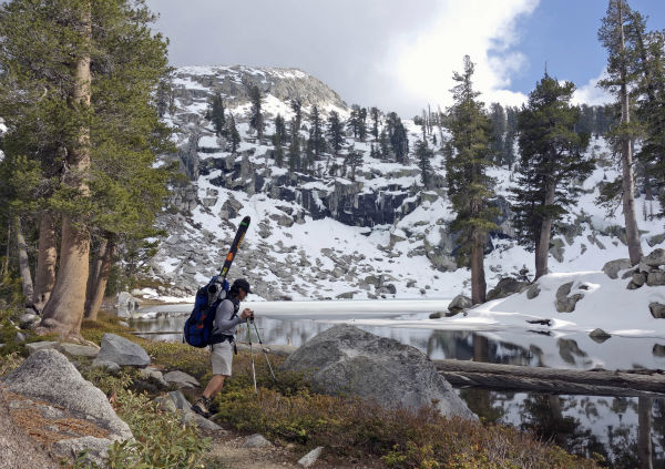 "<div class=""meta image-caption""><div class=""origin-logo origin-image none""><span>none</span></div><span class=""caption-text"">Steven Bonorris pauses at the side of Heather Lake while hiking to the Pear Lake cabin in Sequoia National Park, Calif. (AP Photo/ Brian Melley)</span></div>"