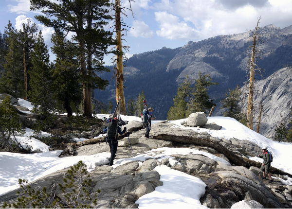 "<div class=""meta image-caption""><div class=""origin-logo origin-image none""><span>none</span></div><span class=""caption-text"">Ned White, left, and Mary Small, center, encounter a hiker on their way toward the Pear Lake cabin on an annual ski-turned-hiking trip in Sequoia National Park (AP Photo/ Brian Melley)</span></div>"