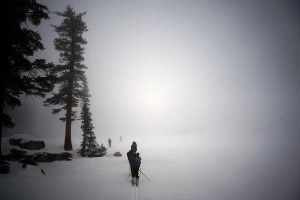 "<div class=""meta image-caption""><div class=""origin-logo origin-image none""><span>none</span></div><span class=""caption-text"">In this March 30, 2014 photo, skiers cross Heather Lake on their way to the Pear Lake cabin in Sequoia National Park, Calif. (AP Photo/ Brian Melley)</span></div>"