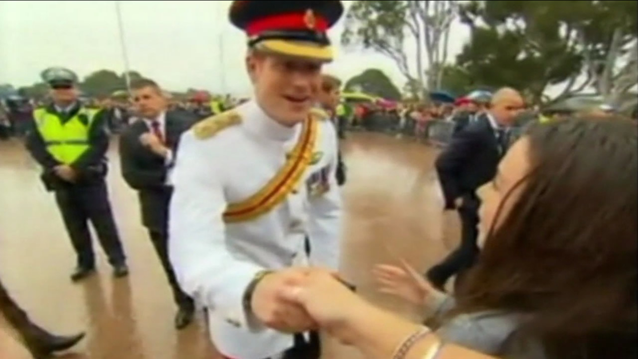Britain's Prince Harry shakes hands with fans in Canberra, Australia on April 6, 2015.