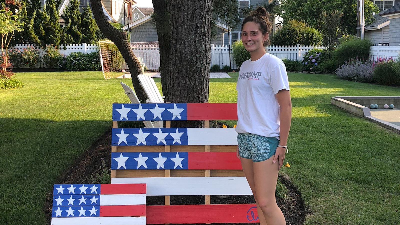 New Jersey teen transforms wooden pallets into yard signs to help families in need