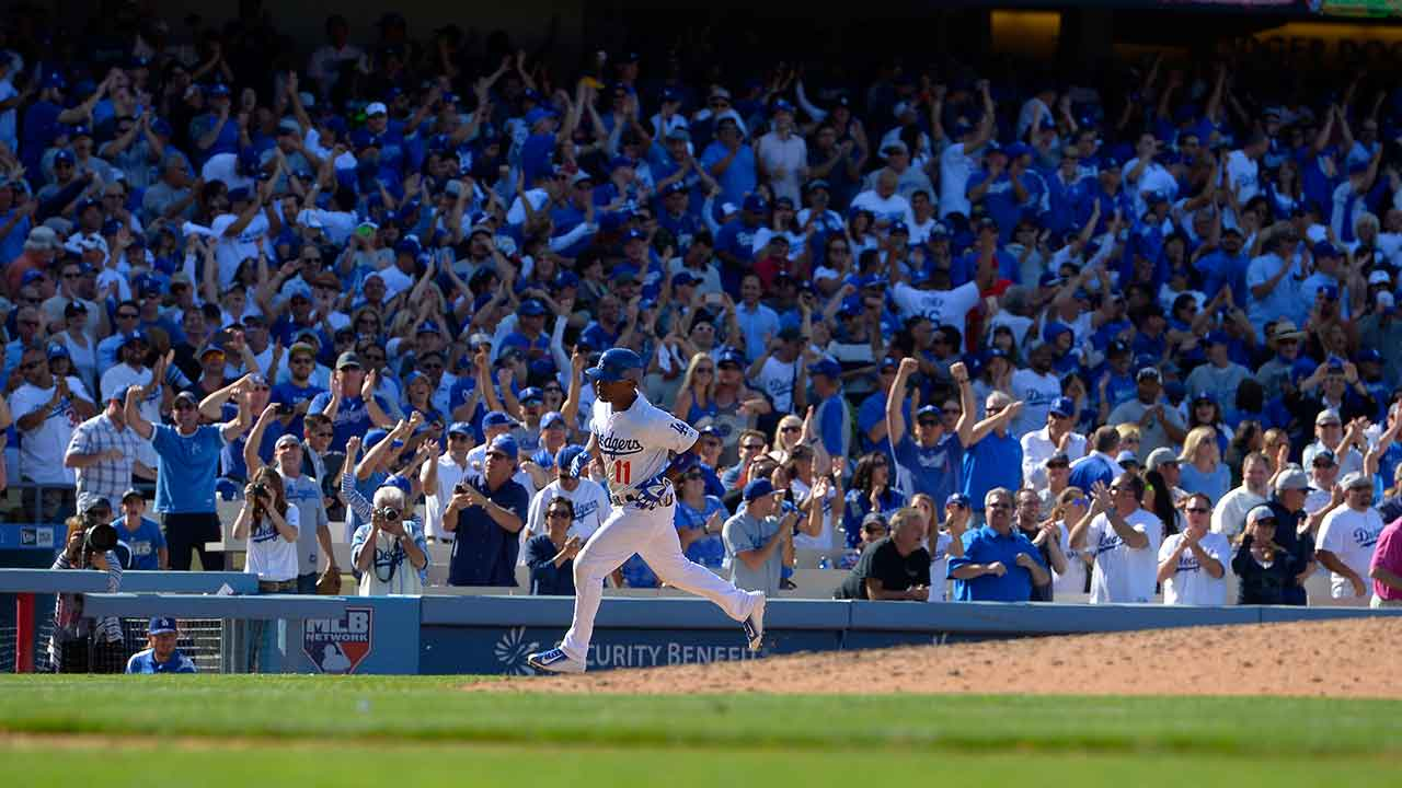 Los Angeles Dodgers' Jimmy Rollins heads to home after hitting a three-run home run during the eighth inning of an opening day baseball game against the San Diego Padres, Monday.