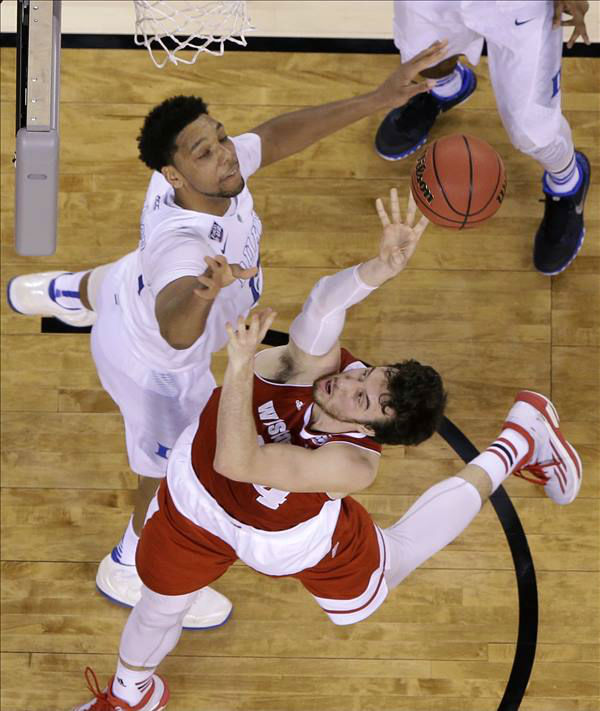 "<div class=""meta image-caption""><div class=""origin-logo origin-image none""><span>none</span></div><span class=""caption-text"">Wisconsin's Frank Kaminsky shoots over Duke's Jahlil Okafor, left. (AP Photo/David J. Phillip)</span></div>"