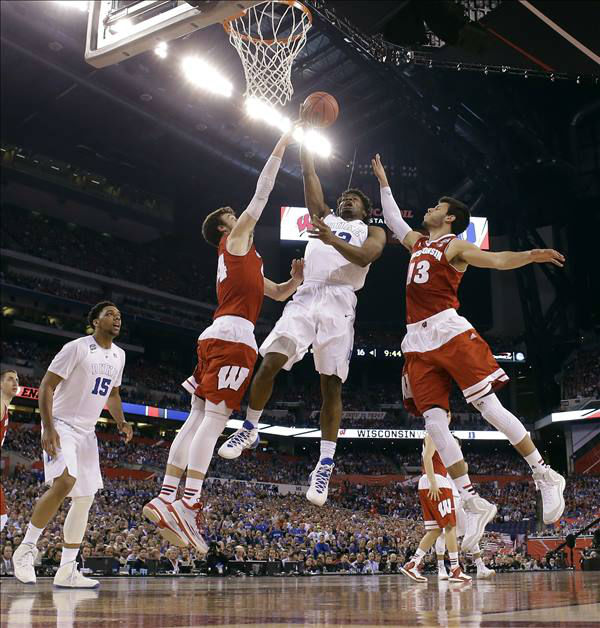 "<div class=""meta image-caption""><div class=""origin-logo origin-image none""><span>none</span></div><span class=""caption-text"">Duke's Justise Winslow (12) goes up for a shot between Wisconsin's Frank Kaminsky (44) and Duje Dukan (13) during the first half. (AP Photo/Michael Conroy)</span></div>"
