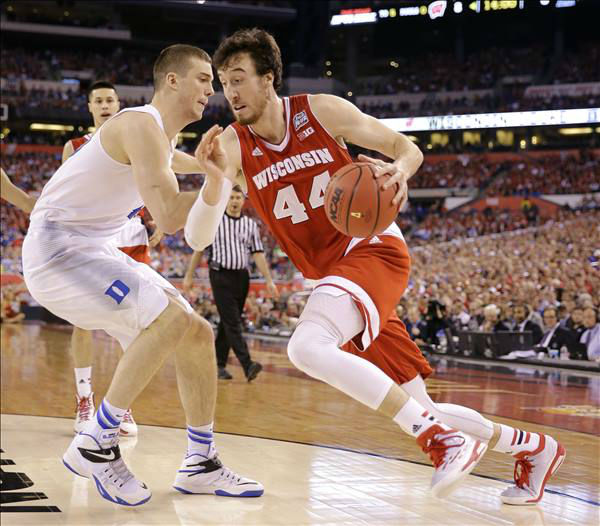 "<div class=""meta image-caption""><div class=""origin-logo origin-image none""><span>none</span></div><span class=""caption-text"">Wisconsin's Frank Kaminsky drives past Duke's Marshall Plumlee, left, during the first half. (AP Photo/David J. Phillip)</span></div>"