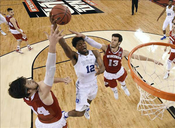 "<div class=""meta image-caption""><div class=""origin-logo origin-image none""><span>none</span></div><span class=""caption-text"">Duke's Justise Winslow (12) goes up for a shot between Wisconsin's Frank Kaminsky (44) and Duje Dukan (13) during the first half. (AP Photo/Chris Steppig, Pool)</span></div>"