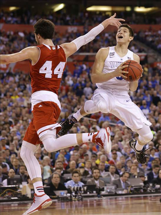 "<div class=""meta image-caption""><div class=""origin-logo origin-image none""><span>none</span></div><span class=""caption-text"">Duke's Grayson Allen drives to the basket ahead of Wisconsin's Frank Kaminsky (44) during the first half. (AP Photo/Michael Conroy)</span></div>"