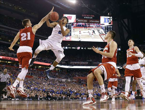 "<div class=""meta image-caption""><div class=""origin-logo origin-image none""><span>none</span></div><span class=""caption-text"">Duke's Quinn Cook (2) goes up for a shot against Wisconsin's Josh Gasser (21) during the first half of the NCAA Final Four college basketball tournament championship game Monday. (AP Photo/Michael Conroy)</span></div>"