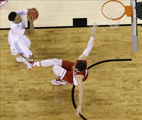 "<div class=""meta image-caption""><div class=""origin-logo origin-image none""><span>none</span></div><span class=""caption-text"">Wisconsin's Frank Kaminsky (44) falls as Duke's Jahlil Okafor (15) drives during the first half. (AP Photo/Michael Conroy)</span></div>"