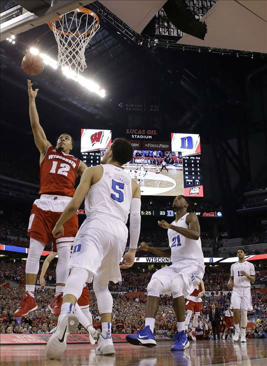 "<div class=""meta image-caption""><div class=""origin-logo origin-image none""><span>none</span></div><span class=""caption-text"">Wisconsin's Traevon Jackson (12) shoots over Duke's Tyus Jones (5) during the first half. (AP Photo/David J. Phillip)</span></div>"
