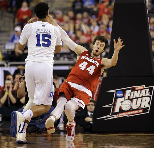 "<div class=""meta image-caption""><div class=""origin-logo origin-image none""><span>none</span></div><span class=""caption-text"">Wisconsin's Frank Kaminsky (44) falls as Duke's Jahlil Okafor (15) drives during the first half. (AP Photo/David J. Phillip)</span></div>"