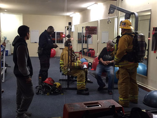 Firefighters provide medical treatment to Ricardo Molina, who was rescued from a six-story building fire.