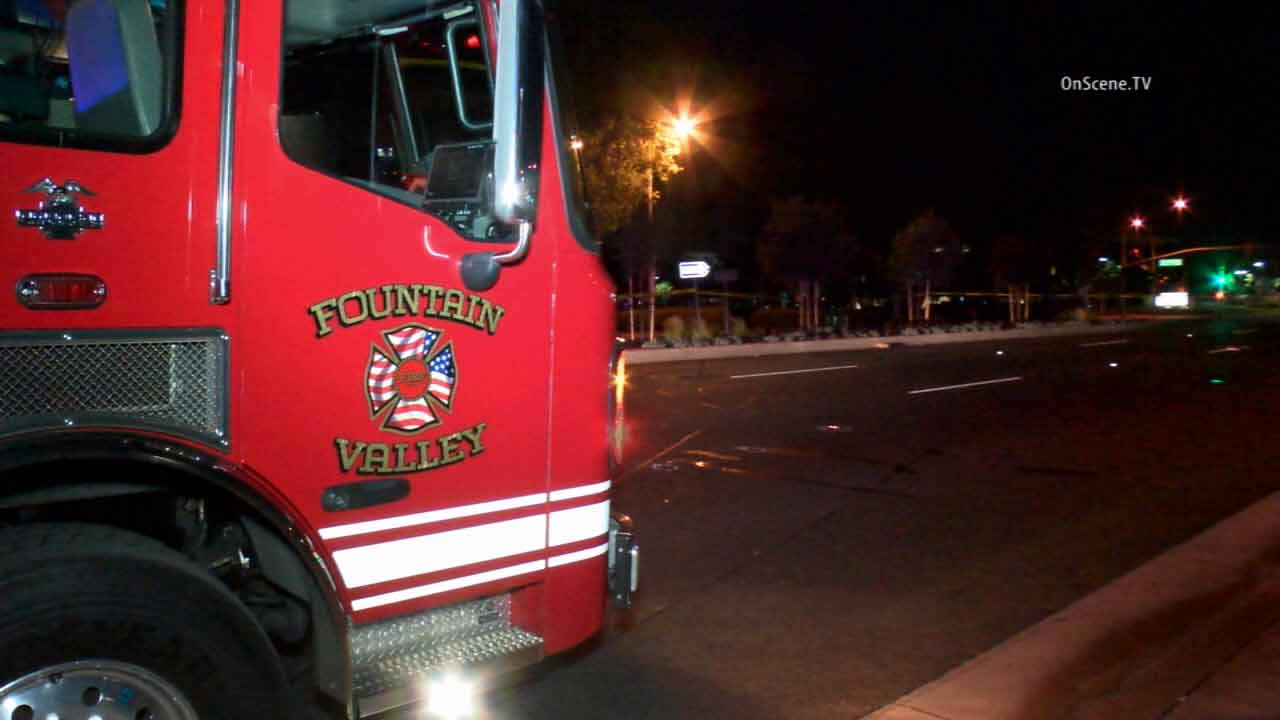 A Fountain Valley fire engine is shown at the scene of a fatal hit-and-run crash near Brookhurst Street on Wednesday, April 8, 2015.