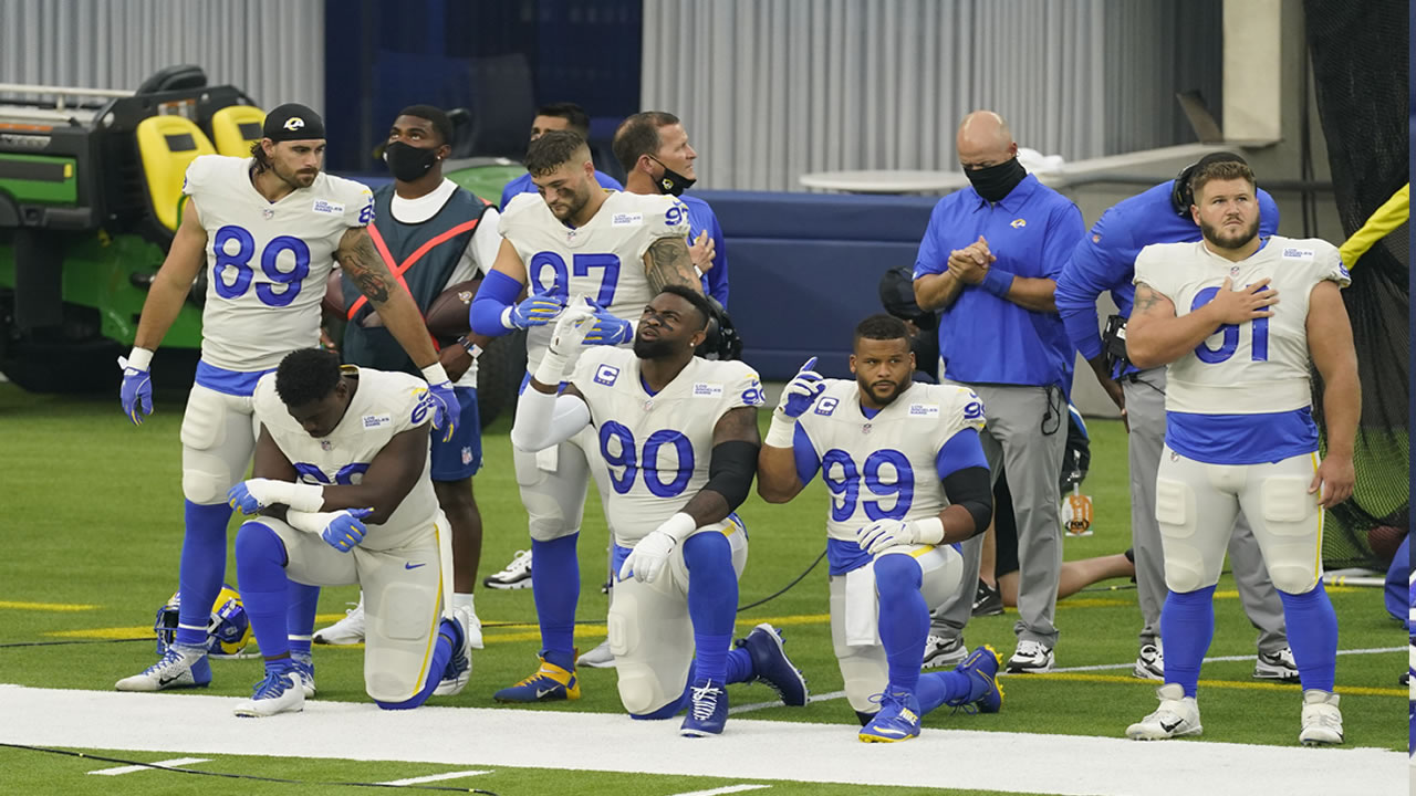 Members of the Los Angeles Rams stand and kneel during the national anthem before an NFL football game against the Dallas Cowboys Sunday, Sept. 13, 2020, in Inglewood, Calif.