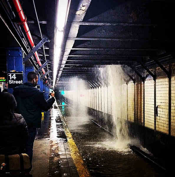 """<div class=""""meta image-caption""""><div class=""""origin-logo origin-image none""""><span>none</span></div><span class=""""caption-text"""">A water main break flooded a subway station in Greenwich Village on Wednesday night. (Instagram/johnvlahakis)</span></div>"""