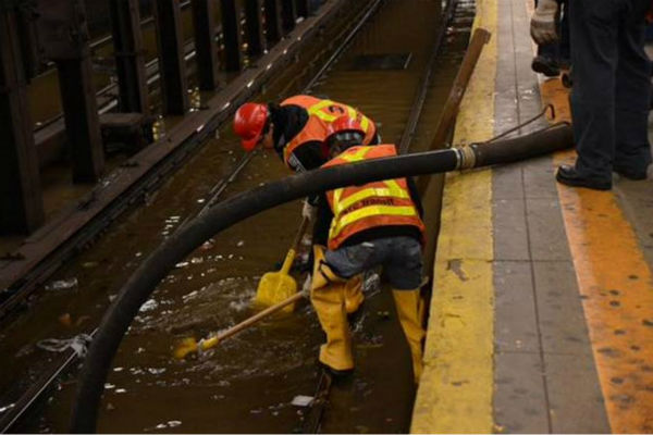 """<div class=""""meta image-caption""""><div class=""""origin-logo origin-image none""""><span>none</span></div><span class=""""caption-text"""">A water main break flooded a subway station in Greenwich Village on Wednesday night. (MTA)</span></div>"""