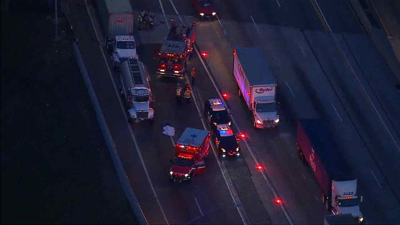 Emergency crews on scene of a fatal crash on the southbound 405 Freeway in Long Beach on Friday, April 10, 2015.