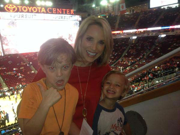 """<div class=""""meta image-caption""""><div class=""""origin-logo origin-image none""""><span>none</span></div><span class=""""caption-text"""">Ilona Carson and her little boys cheering on the Rockets (KTRK Photo)</span></div>"""