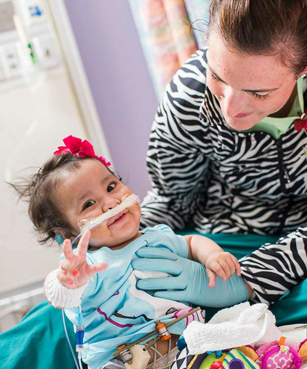 """<div class=""""meta image-caption""""><div class=""""origin-logo origin-image none""""><span>none</span></div><span class=""""caption-text"""">Knatalye Hope and Adeline Faith Mata, formerly conjoined twin girls separated at Texas Children's Hospital, celebrated their first birthday (Allen S. Kramer/Texas Children's Hospital)</span></div>"""