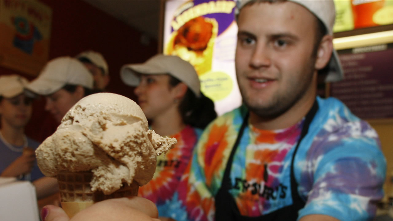 Aleck Woodmaster serves up a free ice cream cone at the Ben & Jerry's shop in Montpelier, Vt., Tuesday, April 25, 2006. (AP Photo/Toby Talbot)