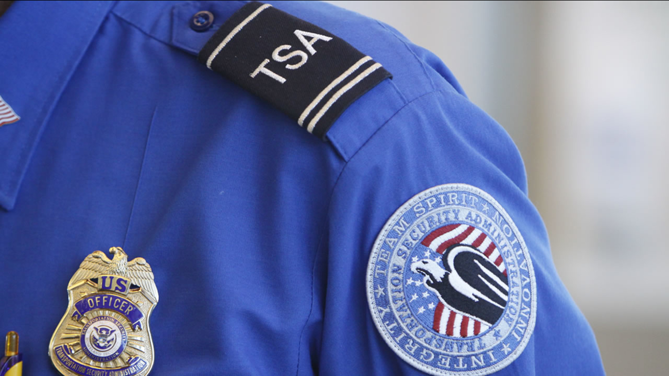 The badge and TSA logo patch are seen on the uniform of a Transportation Security Administration employee. (AP Photo/Jeff Roberson)