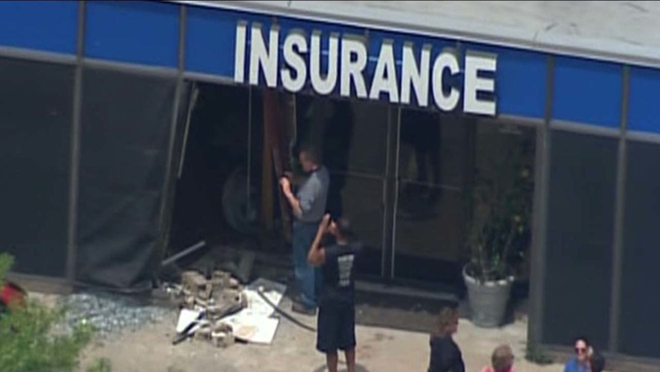 Vehicle into insurance building