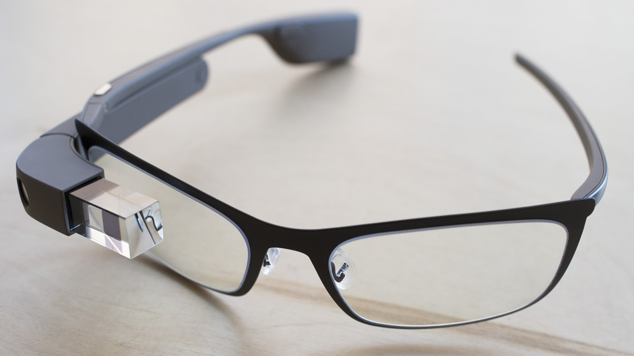"""The new Google Glass """"Bold"""" prescription frames rest on a table at the Google Glass Basecamp space at Chelsea Market, Jan. 24, 2014, in New York. (AP Photo/John Minchillo)"""