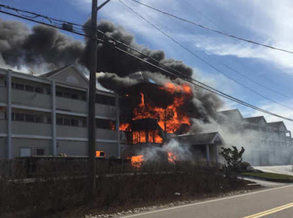 """<div class=""""meta image-caption""""><div class=""""origin-logo origin-image none""""><span>none</span></div><span class=""""caption-text"""">A large fire burned Wednesday at the Sandpiper condo complex in Westhampton Beach, Long Island.</span></div>"""