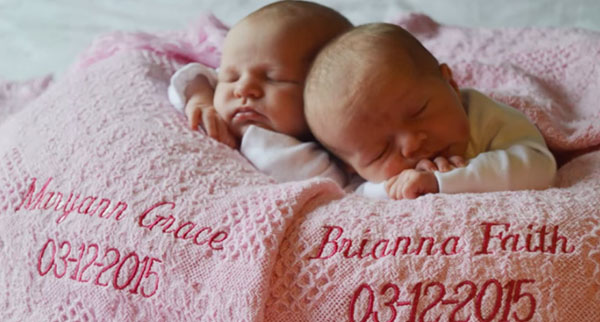 New born twins laying on a blanket
