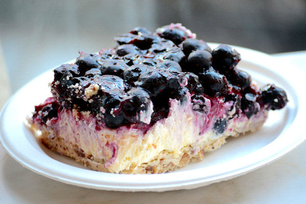 """<div class=""""meta image-caption""""><div class=""""origin-logo origin-image none""""><span>none</span></div><span class=""""caption-text"""">Magnolia's """"blueberry jamboree"""" is a layered icebox dessert on a pecan shortbread crust covered with a cream cheese filling and topped with fresh blueberries (Sabrina Szteinbaum)</span></div>"""