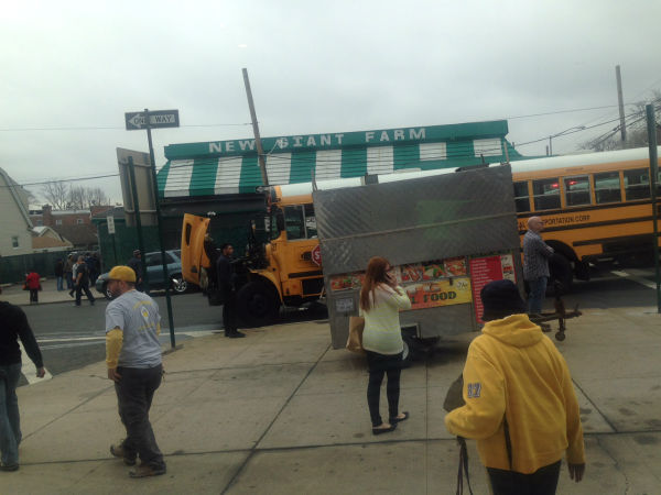 "<div class=""meta image-caption""><div class=""origin-logo origin-image none""><span>none</span></div><span class=""caption-text"">A school bus and a truck crashed in Queens, sending one vehicle into a fruit stand and striking a pedestrian</span></div>"