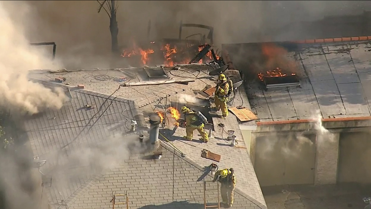 Los Angeles firefighters battle flames in a San Pedro neighborhood on Friday, April 17, 2015.