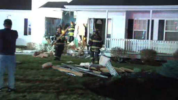 "<div class=""meta image-caption""><div class=""origin-logo origin-image none""><span>none</span></div><span class=""caption-text"">A man is under arrest on charges of driving while intoxicated after police say he crashed into a home in Suffolk County early Saturday.</span></div>"