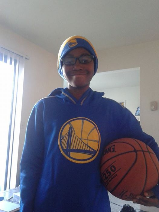 <div class='meta'><div class='origin-logo' data-origin='none'></div><span class='caption-text' data-credit=''>Warriors fan gears up for round one of the playoffs. Photo submitted by Bianca Coleman.</span></div>