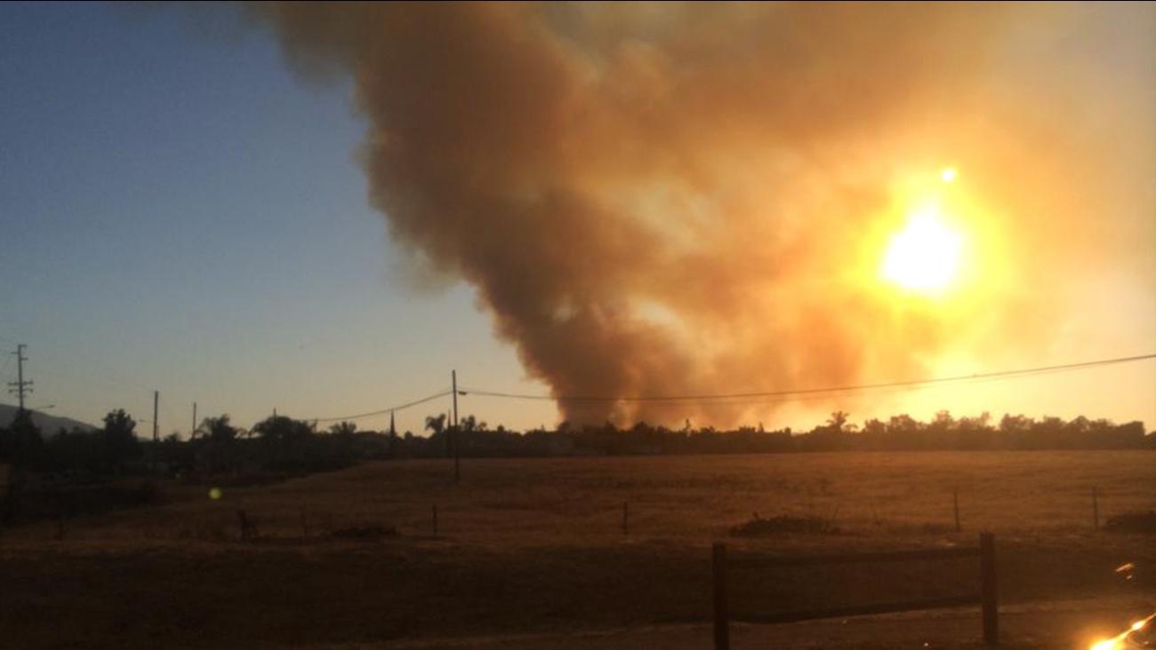 A fire erupted near the Prado Dam Saturday, April 18, 2015.