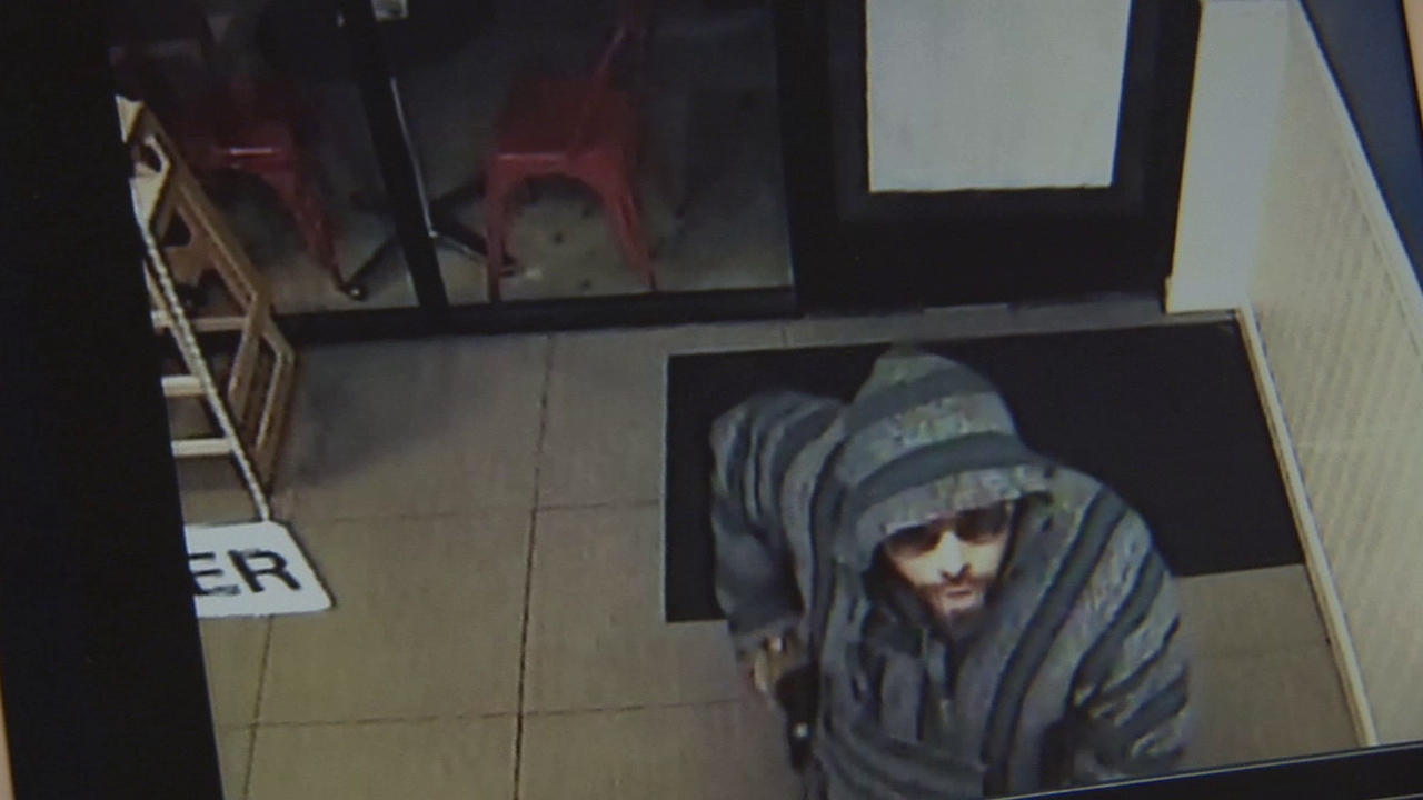 A man robs an ice cream shop in Northridge at gunpoint on Saturday, April 18, 2015.