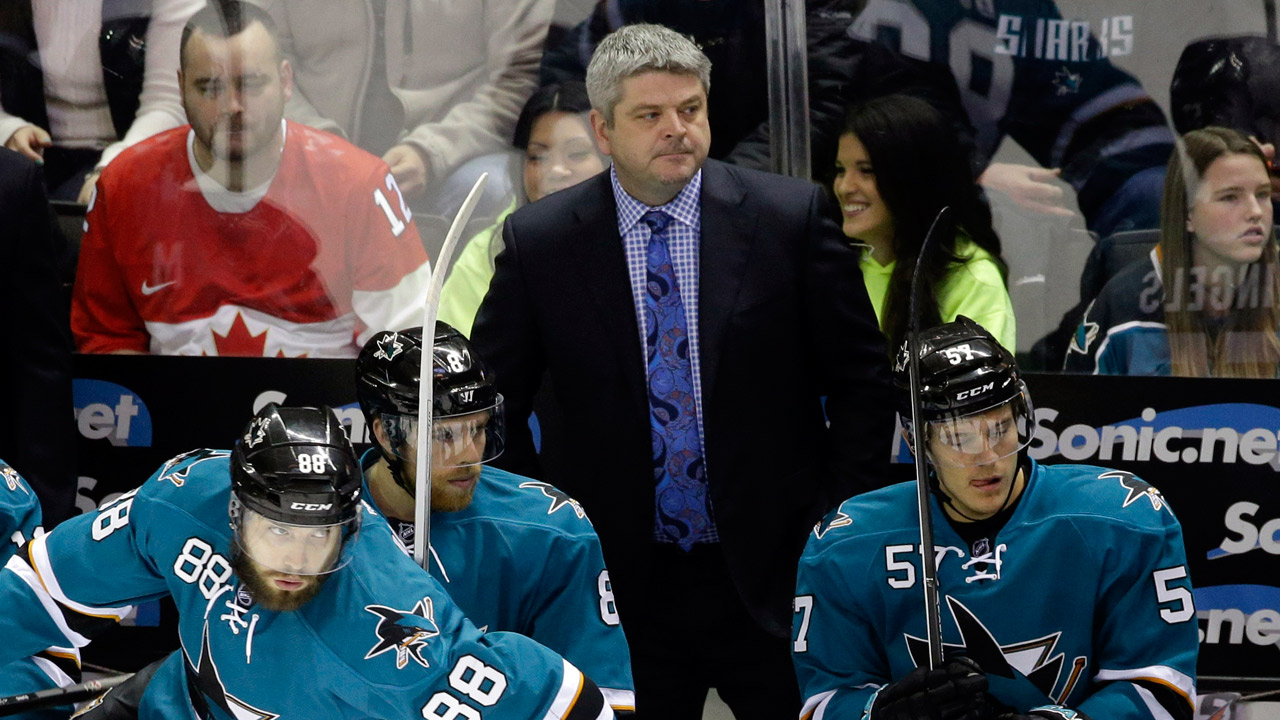 San Jose Sharks head coach Todd McLellan watches his team from the bench during the first period of an NHL hockey game against the Columbus Blue Jackets on Friday, Feb. 7, 2014.