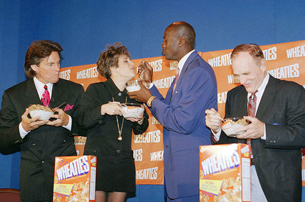 "<div class=""meta image-caption""><div class=""origin-logo origin-image none""><span>none</span></div><span class=""caption-text"">Jenner makes an appearance with fellow athletes Mary Lou Retton, Michael Jordan and Bob Richards (left to right) in a press conference for Wheaties cereal in 1994. (AP Photo/Charles Bennett)</span></div>"